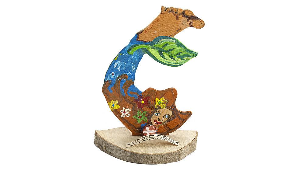 Beidseitig handbemalte Abbildung einer Meerjungfrau auf einer Baumscheibe, davor der Text: 'In CO²penhagen muss was laufen/für Klima- und Urwaldschutz zur UN-Konferenz'.