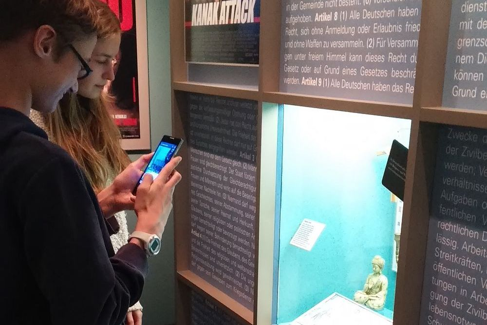 Teens testing out the app in our exhibition