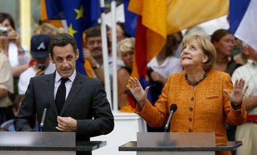 Nicolas Sarkozy und Angela Merkel, Foto: Daniel Karmann (dpa)