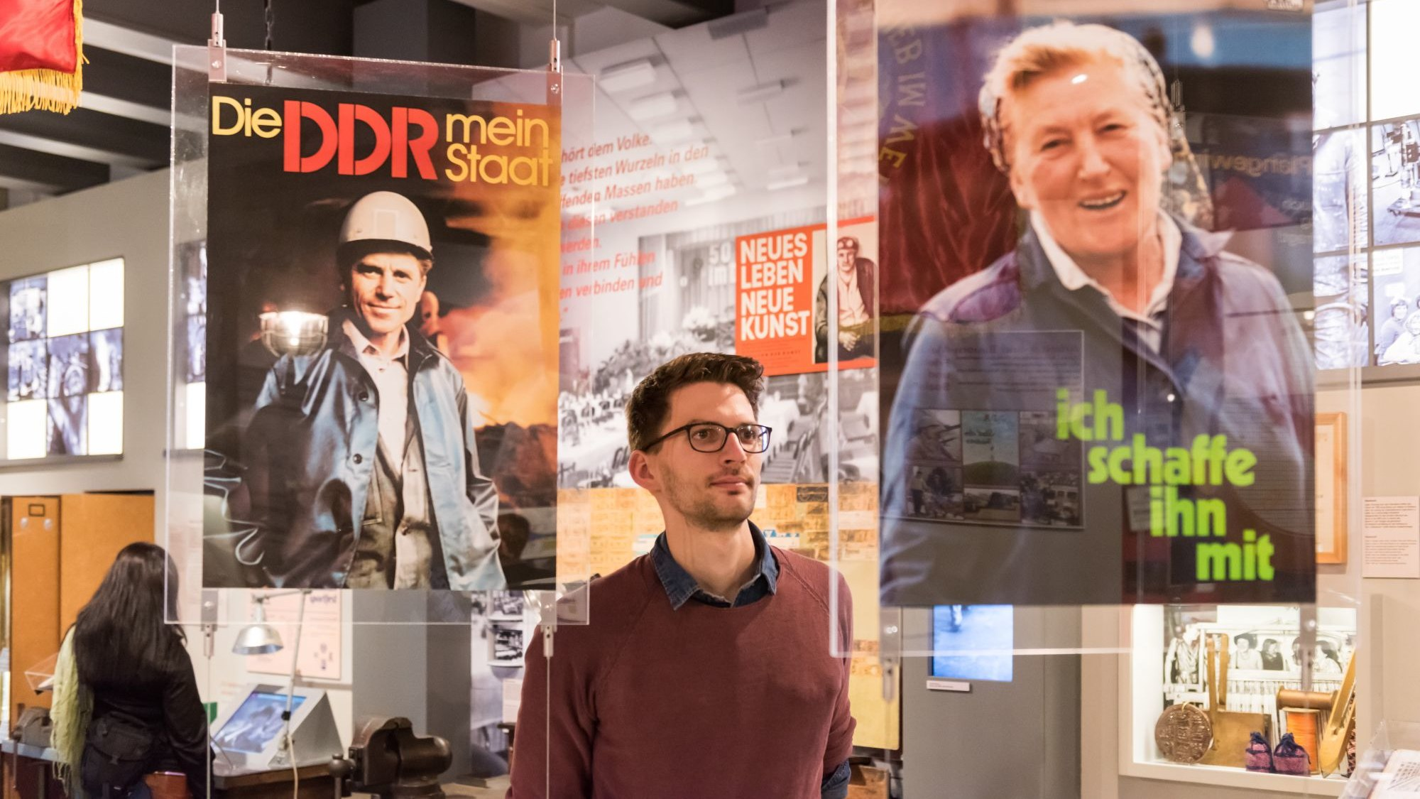 People in the exhibition 'Everyday Life in the GDR' at Museum in der Kulturbrauerei Berlin