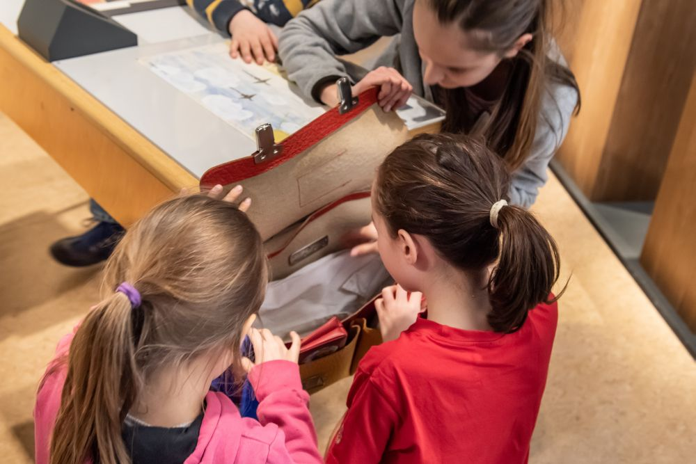 Children exploring the interactive elements of the exhibition
