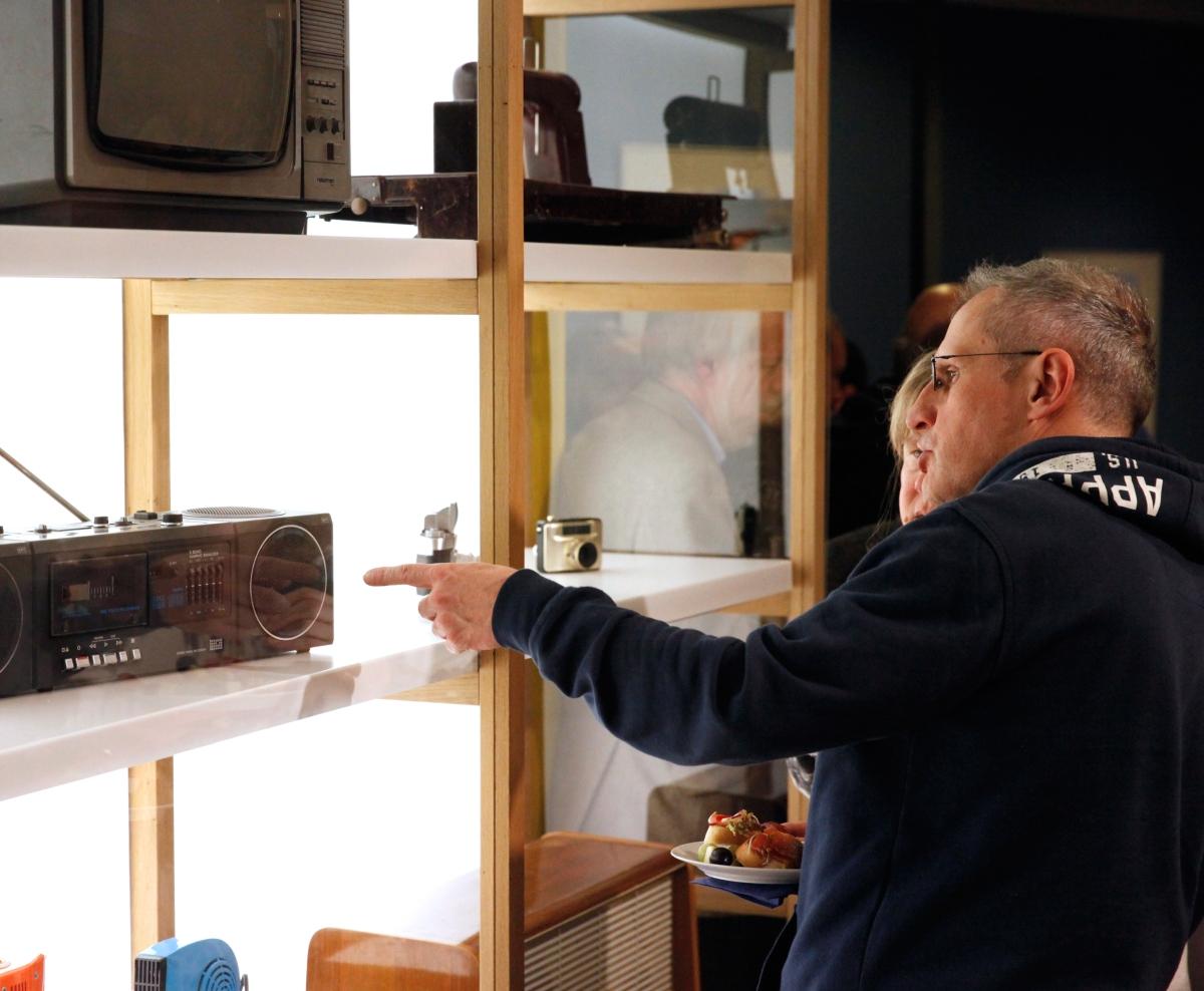 Visitors look at a radio