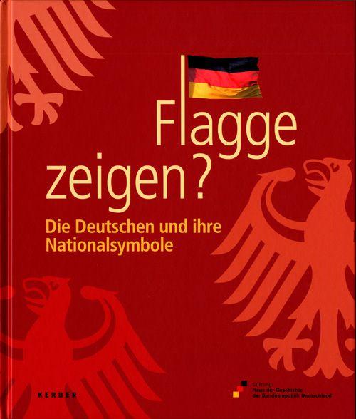 Auf dem roten Cover sind drei Bundesadler jeweils in Teilen zu sehen, das L im Wort Flagge ist durch den kleinen Fahnenmast einer wehenden Deutschland-Flagge ersetzt